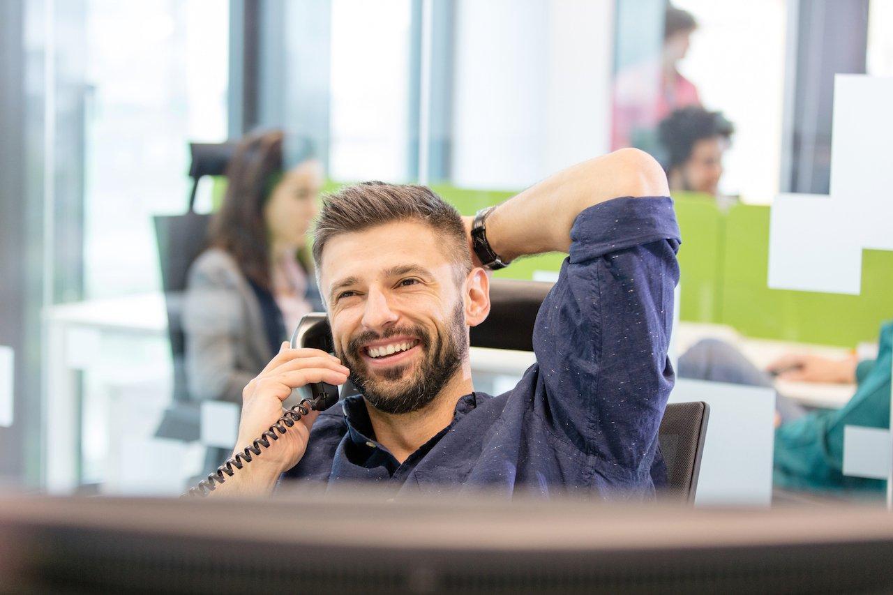 Man talking on office phone